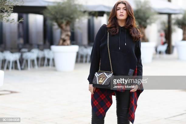 Farina Opoku aka NovaLanaLove wearing a Louis Vuitton bag on November 17 2017 in Cologne Germany