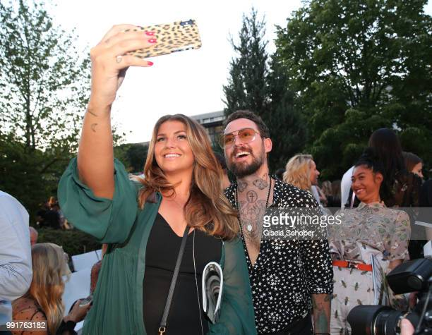 Farina Opoku and Marcel Ostertag take a selfie during the Marcel Ostertag show during the Berlin Fashion Week Spring/Summer 2019 at Westin Grand...