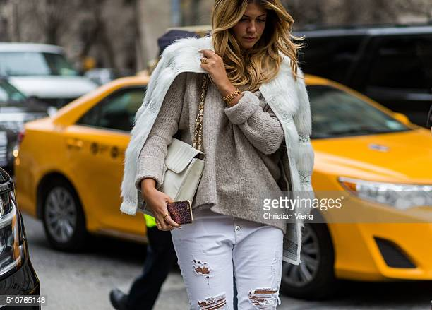 Farina Opoku wearing a white Topshop fur coat an Edited sweater white Replay ripped pants seen outside Tommy Hilfiger during New York Fashion Week...