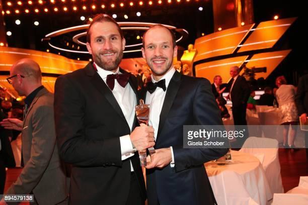 Faris AlSultan coach of Ironman World Champion and Ironman winner 2017 Patrick Lange with award during the 'Sportler des Jahres 2017' Gala at Kurhaus...