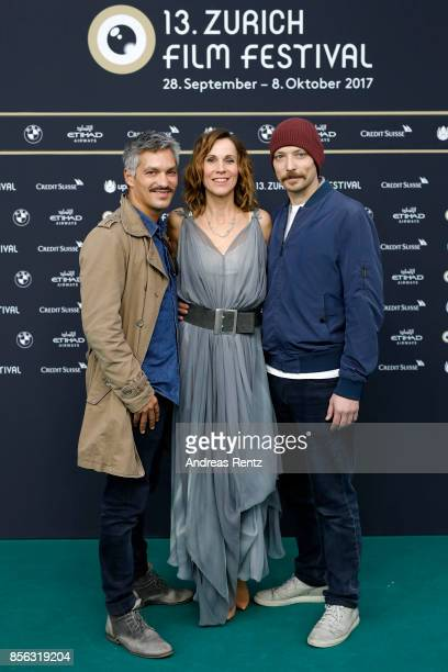 Faris Rahoma Doris Schretzmayer and Arash T Riahi attends the 'Die Migrantigen' photocall during the 13th Zurich Film Festival on October 1 2017 in...
