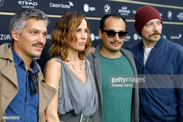 Faris Rahoma Doris Schretzmayer Arman T Riahi and Arash T Riahi attends the 'Die Migrantigen' photocall during the 13th Zurich Film Festival on...