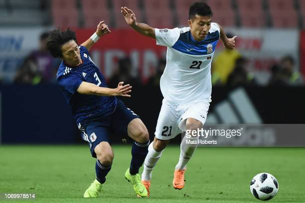 Farkhat Musabekov of Kyrgyz Republic takes on the defence of Sei Muroya of Japan during the international friendly match bewteen Japan and Kyrgyz at...