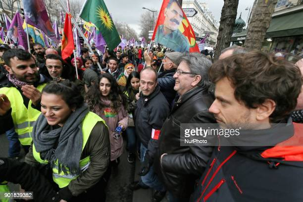 Farleft coalition La France Insoumise leader JeanLuc Melenchon takes part in a demonstration on January 06 2017 in Paris to commemorate the killing...