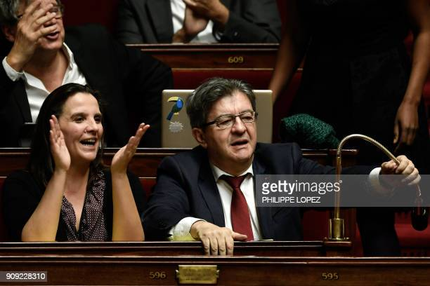 Farleft La France Insoumise party Members of Parliament Caroline Fiat and JeanLuc Melenchon react as they attend a session of questions to the...