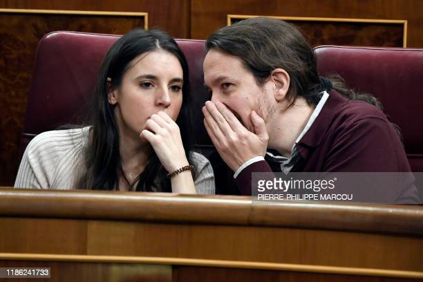 Farleft wing Podemos party's members of parliament Irene Montero and Pablo Iglesias attend the opening session of the Spanish parliament in Madrid on...