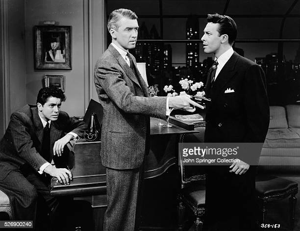 Farley Granger as Phillip Morgan James Stewart as Rupert Cadell and John Dall as Brandon Shaw in Alfred Hitchcock's 1948 film Rope