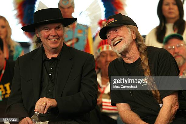 Farm Aid board members Neil Young and Willie Nelson join members of the Farm Aid community at the 20th Anniversary Farm Aid concert benefiting the...