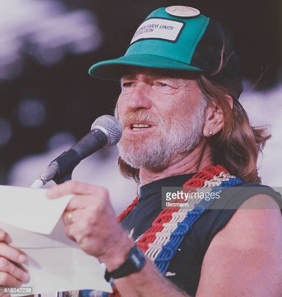Farm Aid. Champaign, Illinois: Willie Nelson reads a letter from Jimmy Cagney expressing his support for the American farmers at the Farm Aid concert...