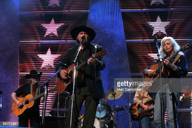 Farm Aid cofounders Willie Nelson and Neil Young are joined by Emmylou Harris at the 20th Anniversary Farm Aid concert benefiting the family farmers...