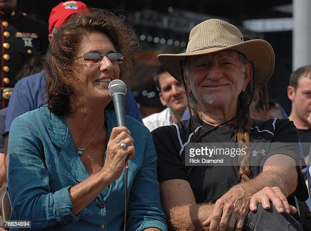 Farm Aid Director Carolyn Mulgar and Farm Aid Founders Willie Nelson answer questions during The Farm Aid 2007 Press Confrence at ICAHN Stadium on...