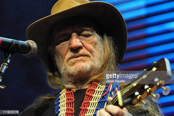 Farm Aid Founder Willie Nelson performs during Farm Aid 2002 Concert and Backstage at PostGazette Pavilion in Burgettstown Pennsylvania United States