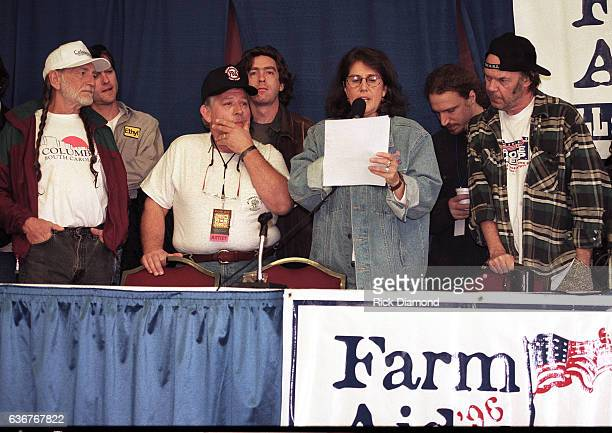 Farm Aid founder Willie Nelson Singer/Songwriter John Conlee Farm Aid Executive Director Carolyn Mugar and Singer/Songwriter Neil Young attend press...