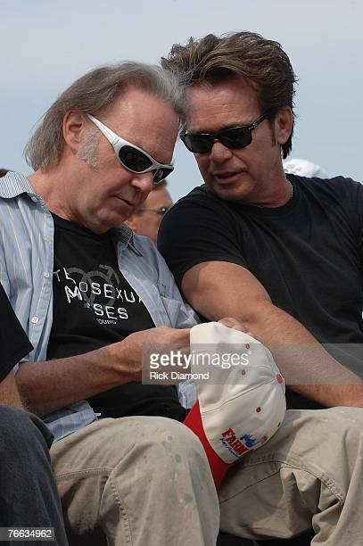 Farm Aid founding members, Neil Young and John Mellencamp answer questions during The Farm Aid 2007 Press Confrence at ICAHN Stadium on Randall's...