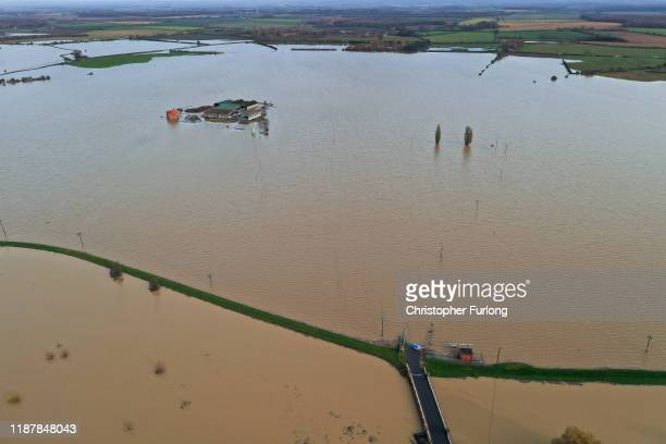 A farm belonging to farmer Henry Ward aged 28 at Bardney near Lincoln is marooned by floodwater after the Barlings Eau broke its banks on November 15...