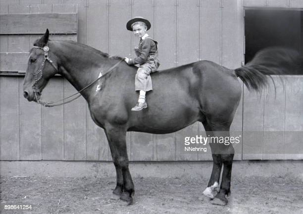 farm boy on draft horse 1931 - 1931 stock pictures, royalty-free photos & images