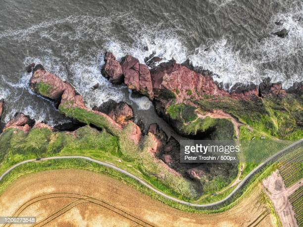 farm by beautiful cliffs - coastline stock pictures, royalty-free photos & images