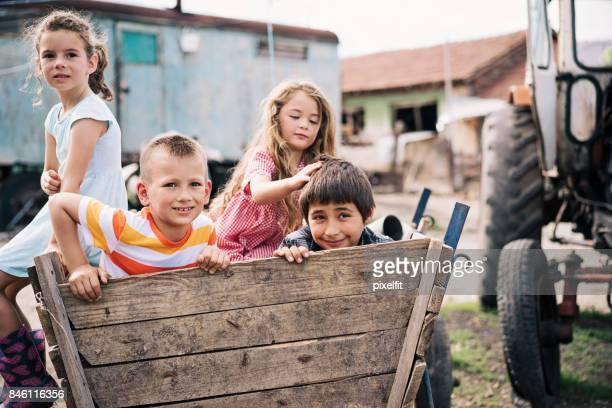 Farm children in a cart