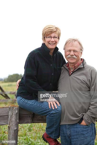Farm Couple on Fence