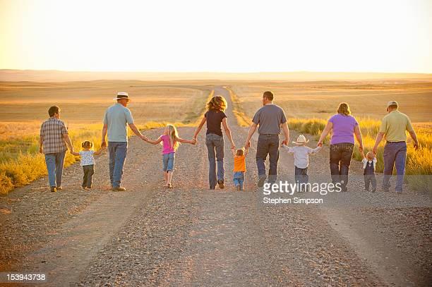 farm family/generations walking empty gravel road