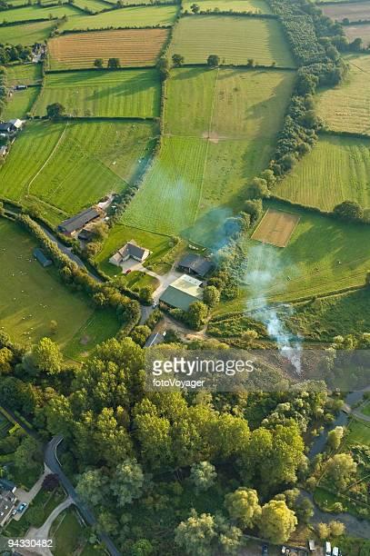 Farm, fields and smoke
