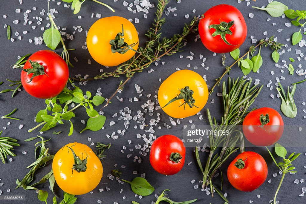 Farm fresh tomatoes with fresh  herb and rock salt : Stock Photo