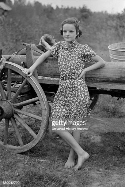 Farm Girl Leaning on Wagon near Morganza Louisiana USA Russell Lee November 1938