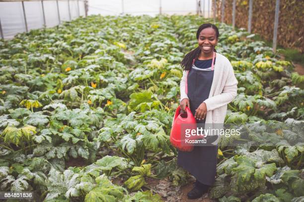 Farm Girl Watering Fresh Vegetables
