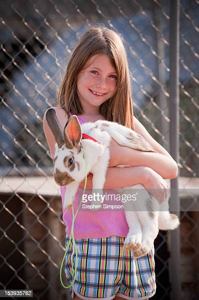 farm girl with her pet rabbit