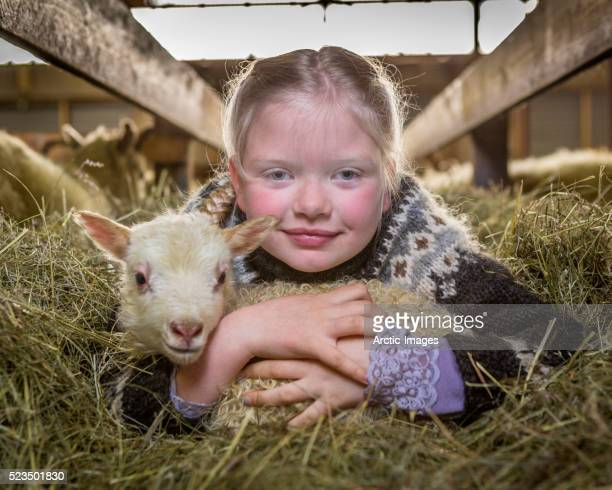Farm girl with young lamb, Western Iceland