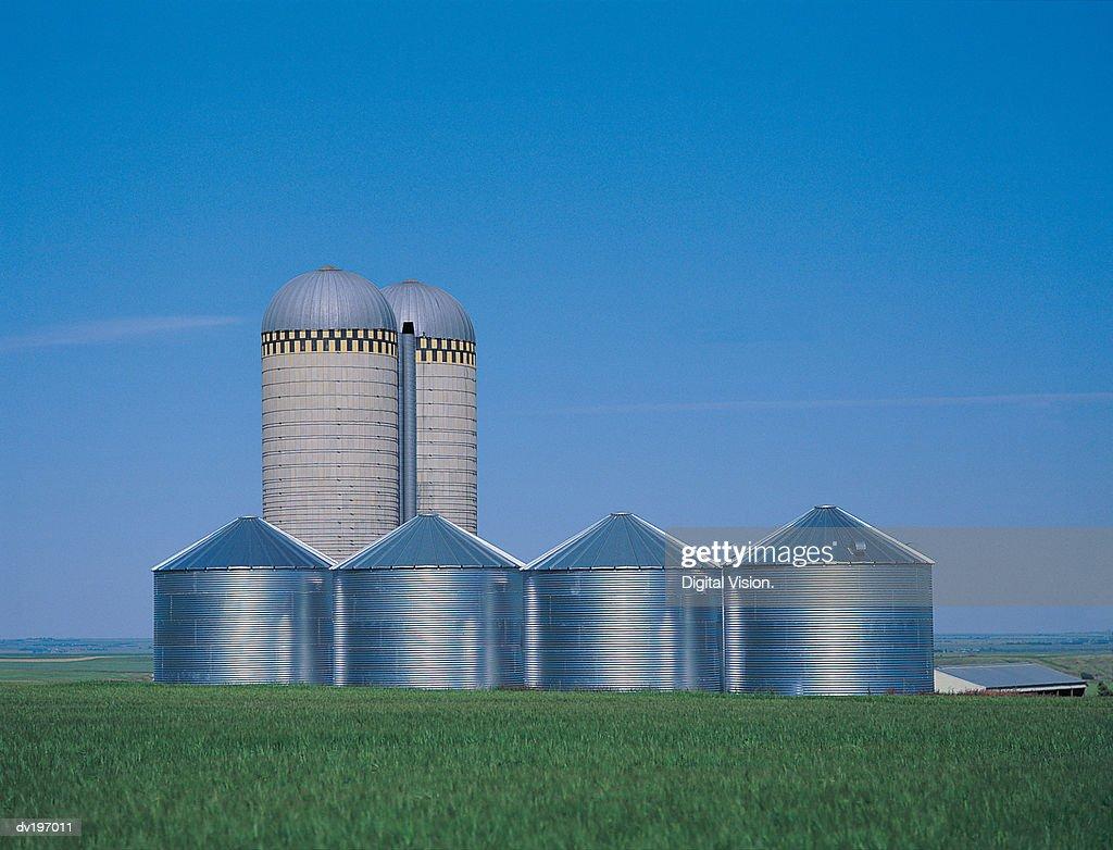 Farm granaries and silos : Stock Photo