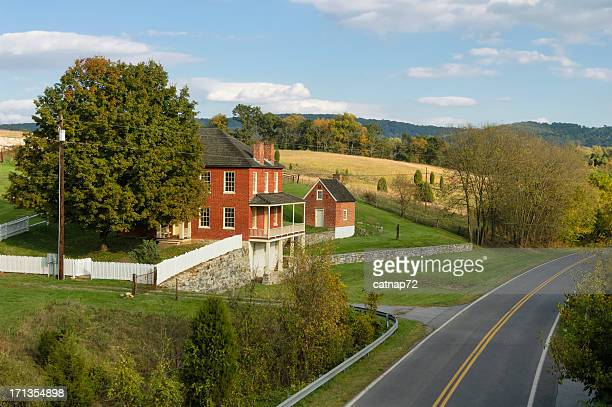 farm house along scenic country road, antietam battlefield, maryland - antietam national battlefield stock photos and pictures