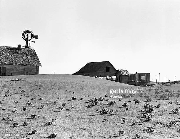 Farm in the dustbowl. Although others in the area have been abandoned, this farm is occupied. Near Dalhart, Texas. June 1938.