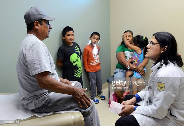 Farm laborer Javier Carreon talks to Dr Luis Martinez during an exam at Clinica Sierra Vista in Fresno California Carreon is one of the many...