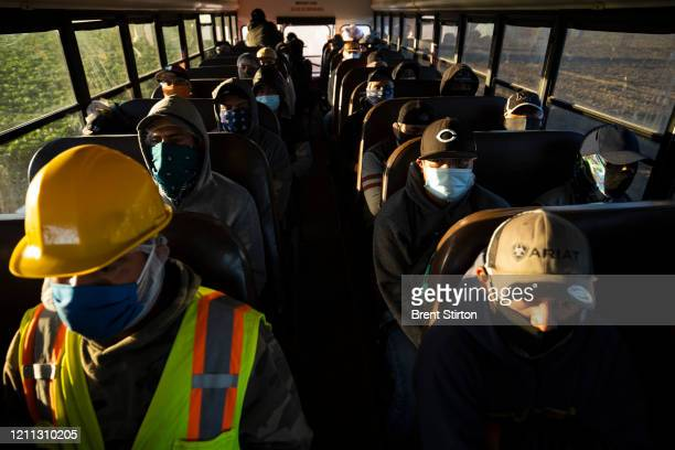 Farm laborers from Fresh Harvest arrive for their shift on April 28, 2020 in Greenfield, California. The industry has looked at placing fewer...