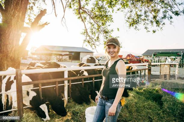 farm life - portrait of young american agricultural worker - young animal stock pictures, royalty-free photos & images