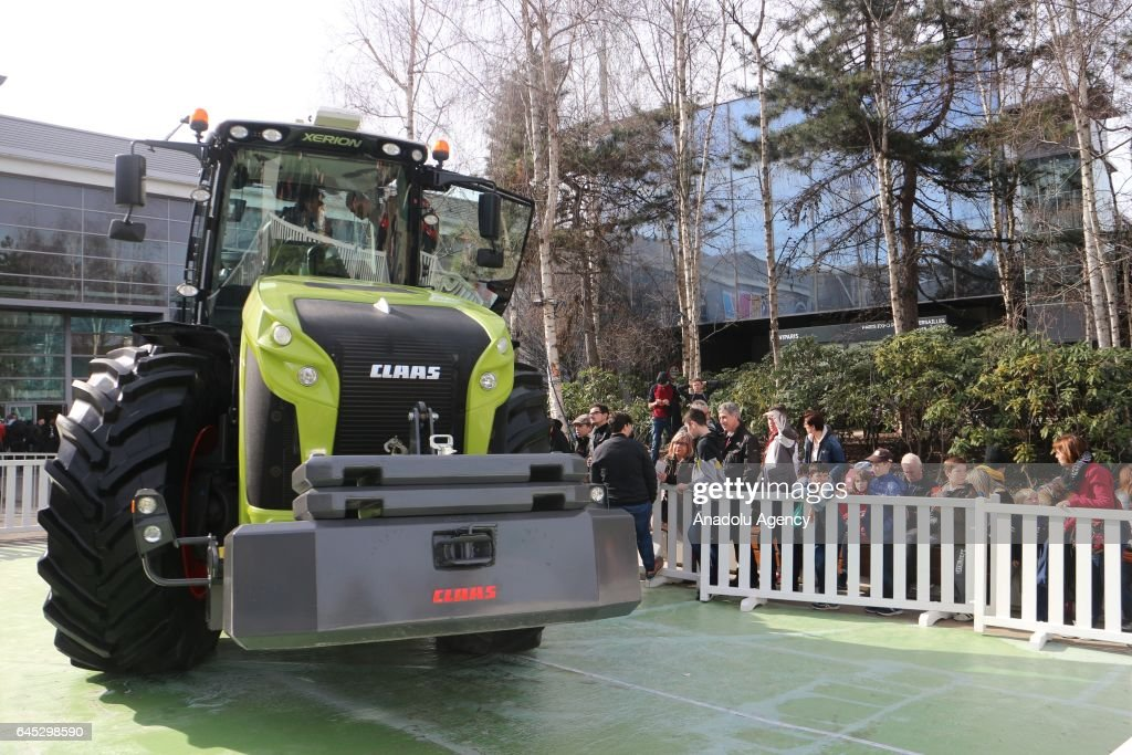A farm machine is being displayed during the 54th Paris International Agricultural Fair at the Porte de Versailles exhibition centre in Paris, on February 25, 2017. Approximately 4000 bovines are exhibited as well as fruits and vegetables on the fair. Above 700.000 people visited the France's most important fair, last year. The fair is open between the dates 21st of February - 1st of March 2015.