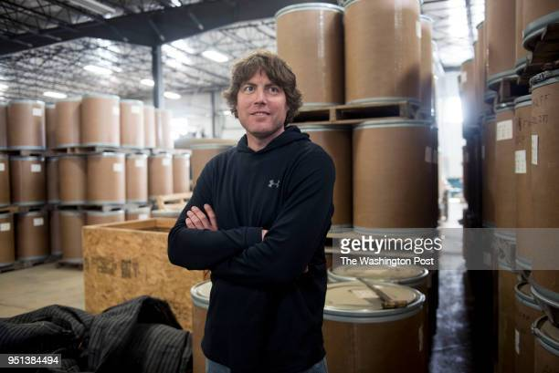 Farm Manager Nickolas Sandquist stands in front of roughly 80000 pounds worth of ginseng that is ready to be shipped to China as seen at Hsu Ginseng...
