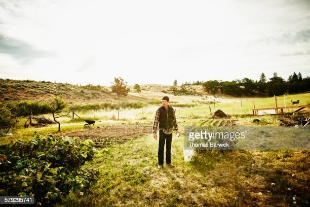 Farm owner standing in vegetable garden
