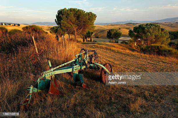 Farm plow at sunset, Tuscany
