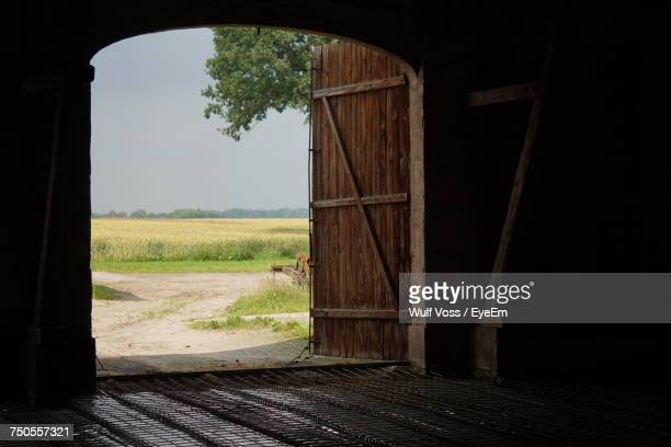 Farm Seen Through Doorway Of Stable