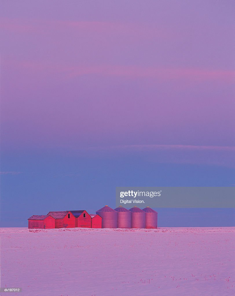 Farm sheds and granaries in winter : Stock Photo