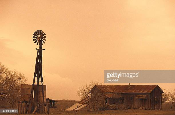 farm with windmill - american style windmill stock pictures, royalty-free photos & images