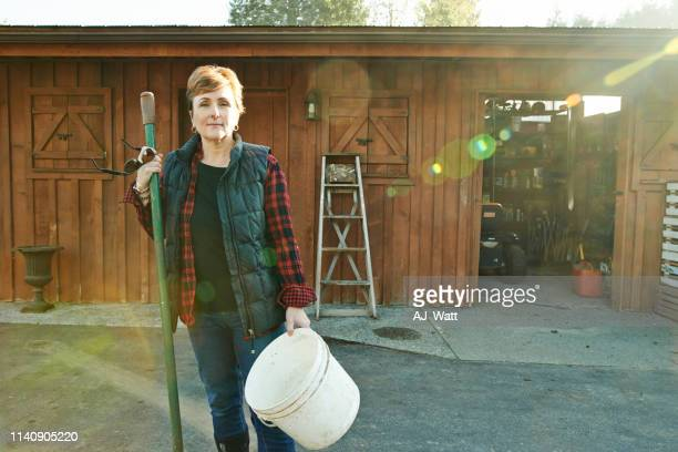 farm work is hard work...it's also the best work - daily bucket stock pictures, royalty-free photos & images