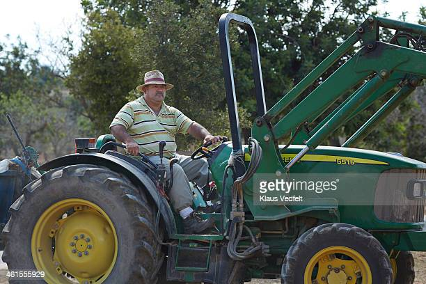 farm worker driving big tractor - klaus vedfelt mallorca stock pictures, royalty-free photos & images