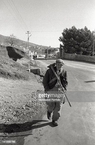 A farm worker from San Giovanni Rotondo with the village behind him Italy