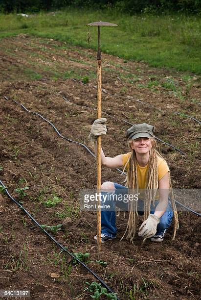 farm worker holding hoe in field, portrait - get your hoe ready stock pictures, royalty-free photos & images