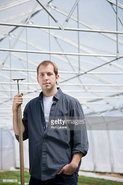 farm worker in an organic farm's greenhouse - get your hoe ready stock pictures, royalty-free photos & images