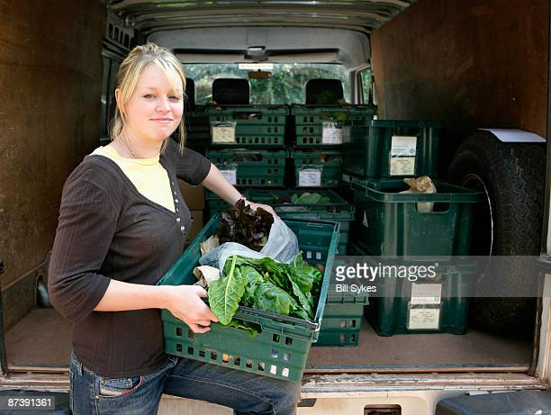 farm worker loading van
