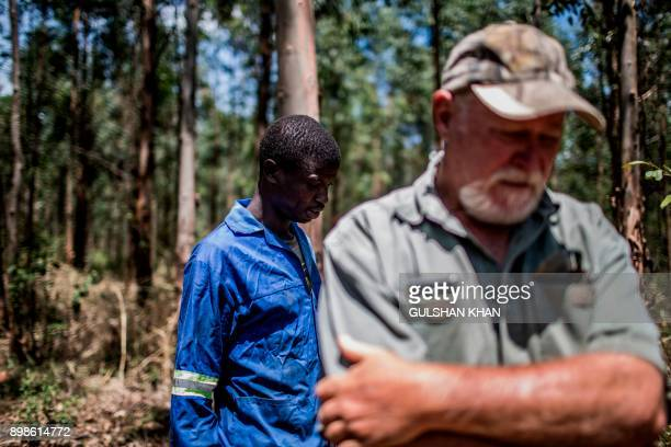 Farm worker Mogoala Justice Ratalele stand near his boss farmer Hans Bergmann after an incident in which he was held at gunpoint for the theft of the...